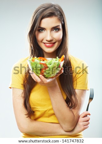 Woman diet concept portrait. Female model hold green salad. Isolated portrait. - stock photo