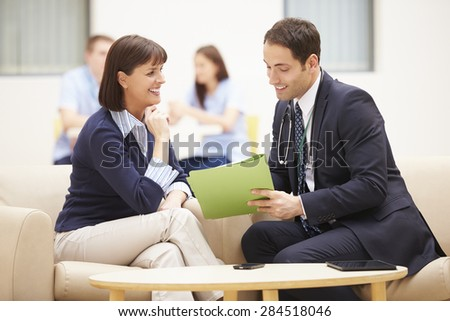 Woman Discussing Test Results With Doctor