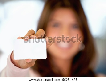 Woman displaying a presentation indoors - blurry background