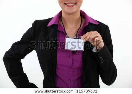 Woman displaying visitor badge - stock photo