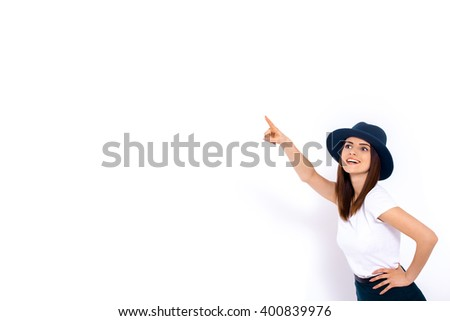 Woman displaying your product Portrait of cheerful young woman displaying your product over white background - stock photo