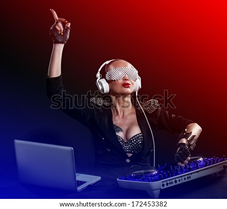 woman dj playing music at party