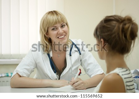 Woman doctor and patient in clinic