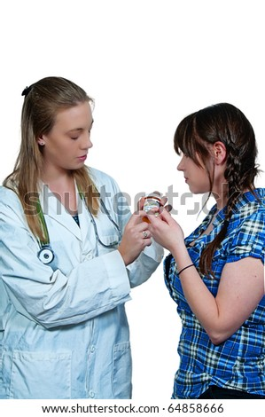 Woman Doctor and Patient with Pill - Laughter is the Best Medicine - stock photo