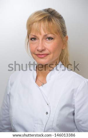 Woman Doctor At The Hospital Standing Against The Wall - stock photo