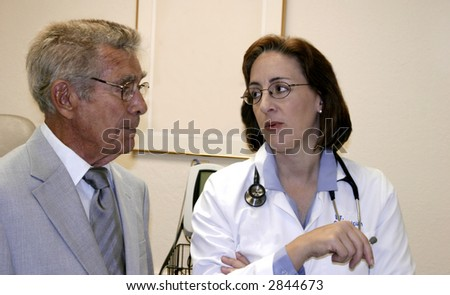 Woman doctor, geriatrician discussing healthy lifestyles with elderly man.