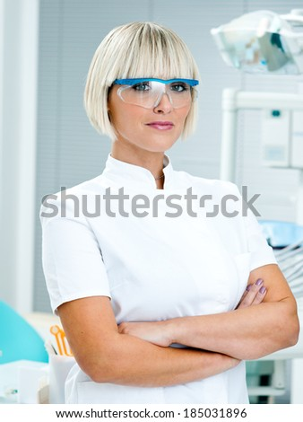woman doctor gynecologist or oncologist smiling in her office - stock photo