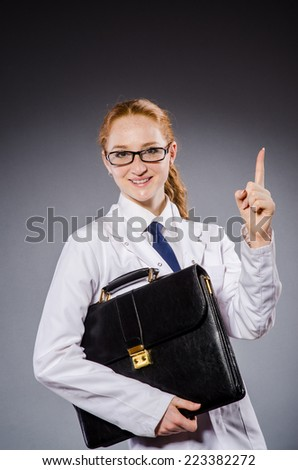 Woman doctor in medical concept - stock photo