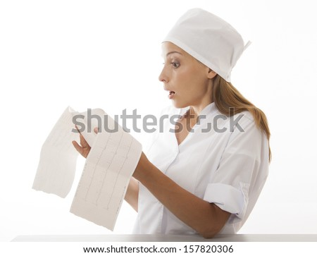 woman doctor looks cardiogram, isolated on white background