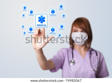 Woman doctor pressing digital button, selective focus, medical theme - stock photo