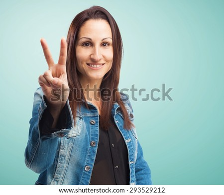 woman doing a number two gesture - stock photo
