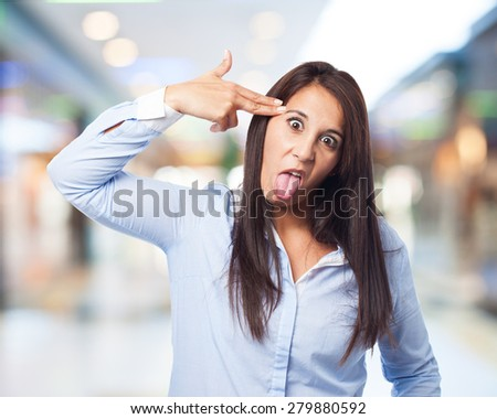 woman doing a suicide gesture