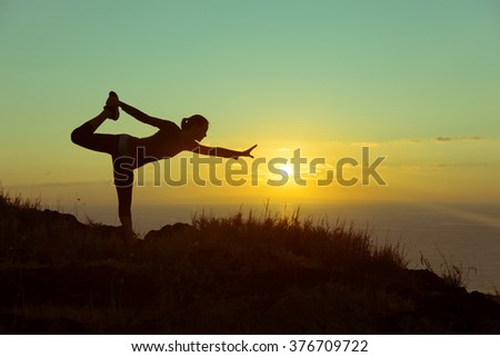 Woman doing an early morning stretching - stock photo