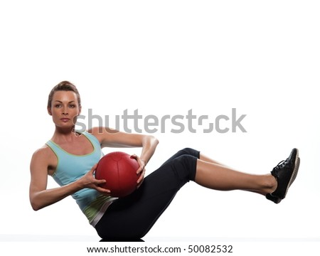woman doing ball abdominals workout posture on isolated white background - stock photo