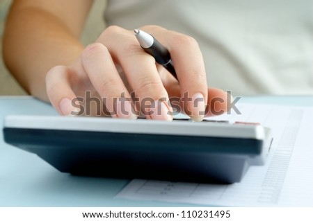 woman doing calculations on a calculator