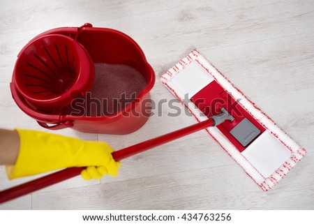 Woman doing cleaning floor at home close up - stock photo