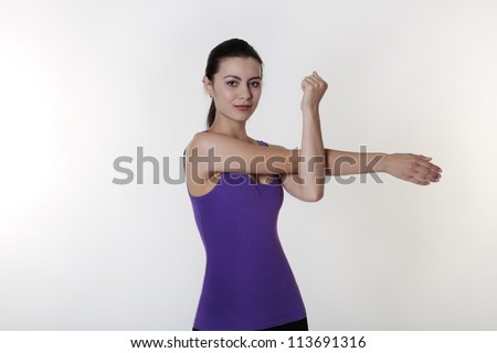 woman doing her daily stretching routine - stock photo