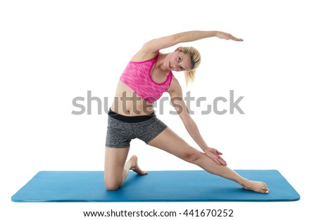 Woman doing leg and back stretching exercises isolated on a white background.