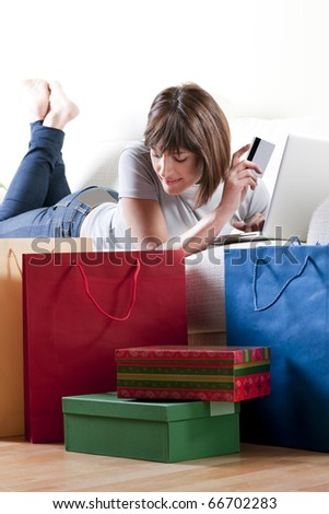 Woman doing online shopping - stock photo