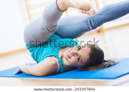 Woman doing pilates workout at gym for muscle toning and weight loss. - stock photo