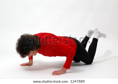 woman doing push ups - stock photo