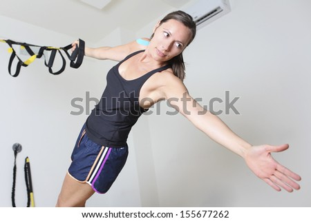 Woman doing trx suspension training - stock photo