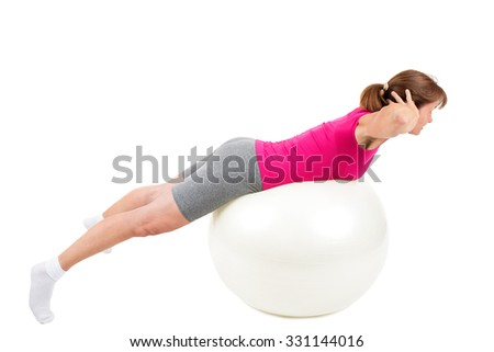 Woman doing workout with gymnastic ball - stock photo