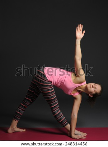 Woman doing yoga. - stock photo