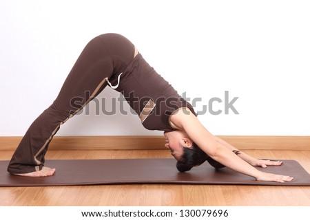 woman doing yoga exercise - stock photo