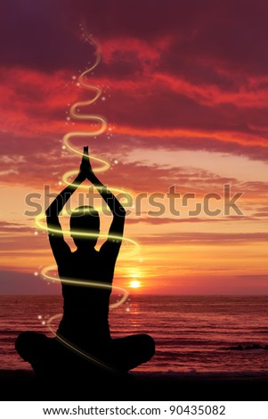 Woman doing yoga exercise at the beach, energetic light and glow effect. - stock photo