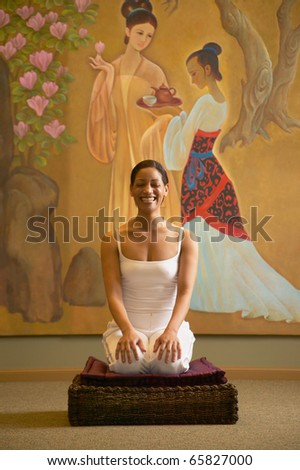 Woman doing yoga in spa room