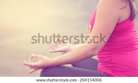 woman doing yoga on top of mountain ridge with instagram filter - stock photo
