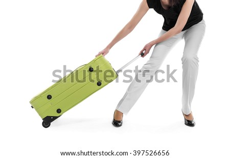 Woman drags a heavy suitcase on a white background. - stock photo