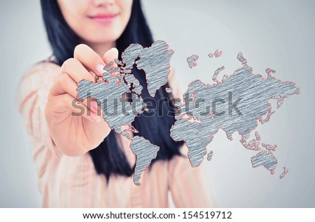 woman drawing the world map, isolated on grey background - stock photo