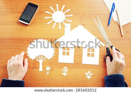 Woman dreaming about big house in countryside. Abstract conceptual image - stock photo