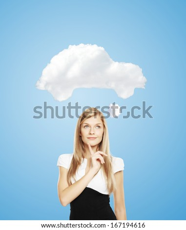 woman dreaming  of a new car - stock photo