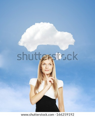 woman dreams of a new car - stock photo