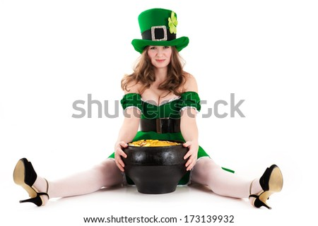 woman dressed as a leprechaun sitting on the floor with a pot of gold