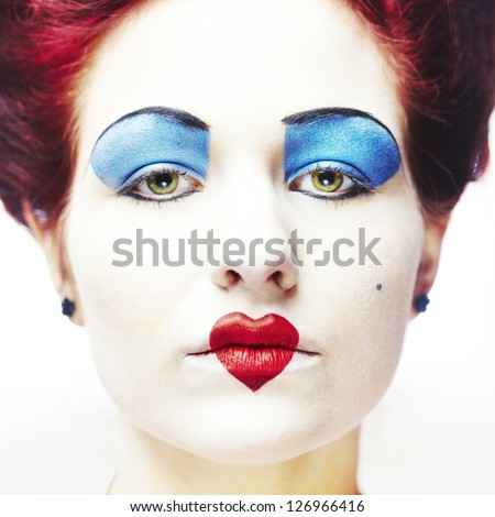 Woman dressed as the queen of hearts portrait - stock photo