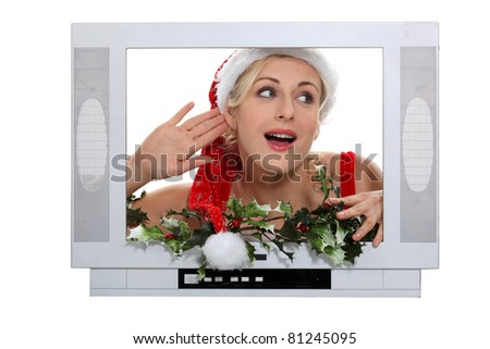 Woman dressed in Christmas outfit, stood in front of fake TV