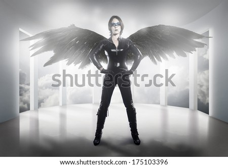 woman dressed in latex, whip and black wings - stock photo