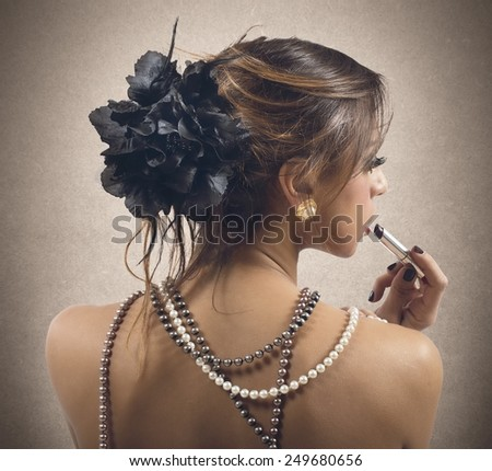 Woman dressed only in strings of pearls - stock photo