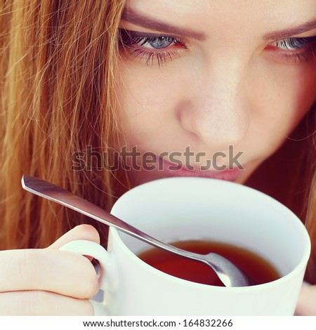 woman drink tea - stock photo