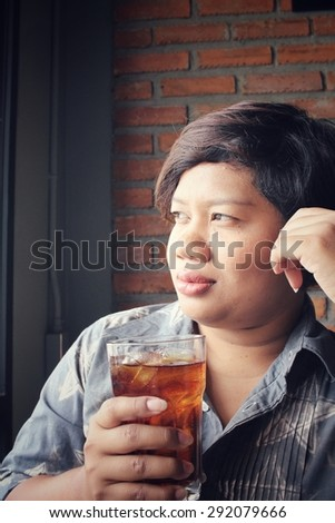 Woman drinking a cola - stock photo