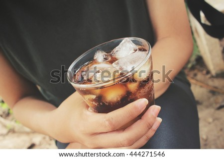 Woman drinking a cola
