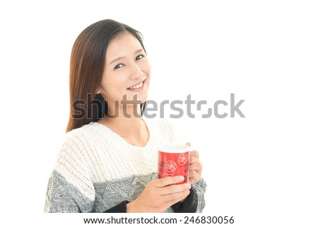 Woman drinking a cup of coffee