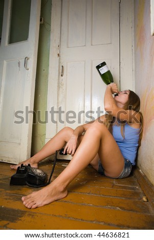 Woman drinking after phone call.