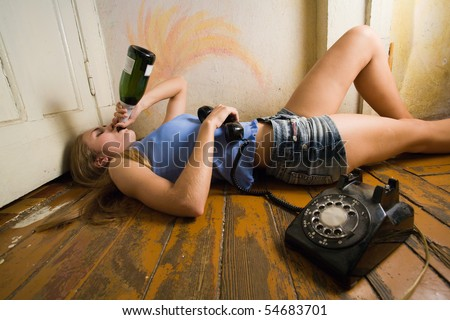 Woman drinking after phone call. - stock photo