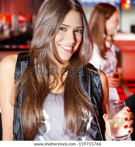 woman drinking cocktail during a party - stock photo