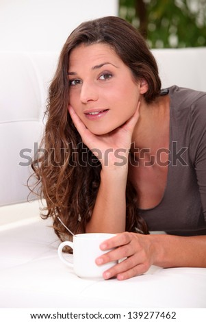 Woman drinking coffee - stock photo